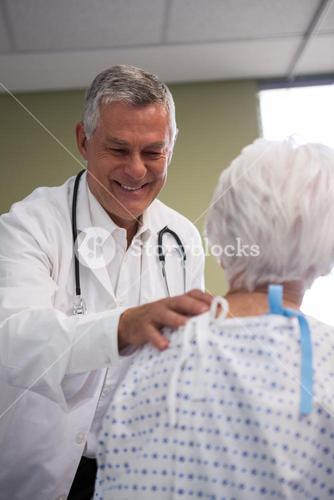 Doctor consoling senior patient