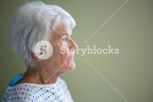 Senior patient standing in hospital