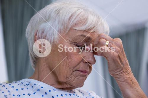 Tensed senior patient at hospital
