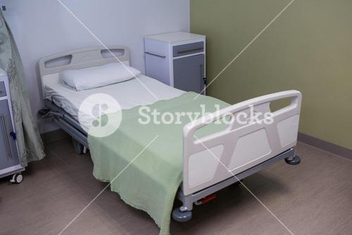 Empty bed in ward at hospital