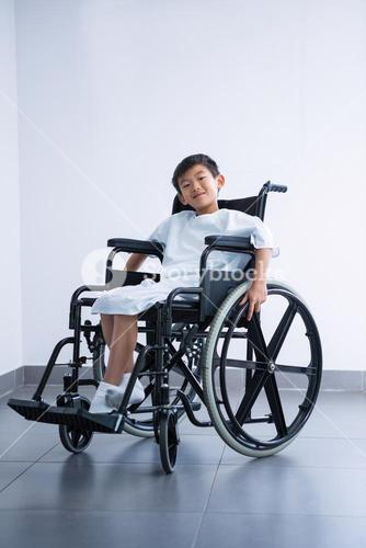 Smiling disabled boy patient on wheelchair at hospital