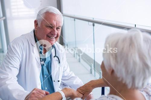 Doctor interacting with senior patient