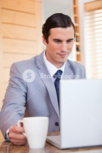 Businessman with laptop and coffee