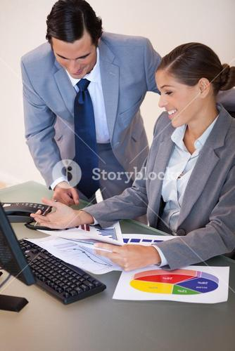 Business people working on diagrams together