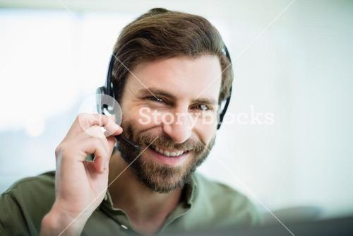 Smiling customer service executive working in call center