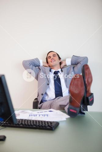 Businessman putting his feet up