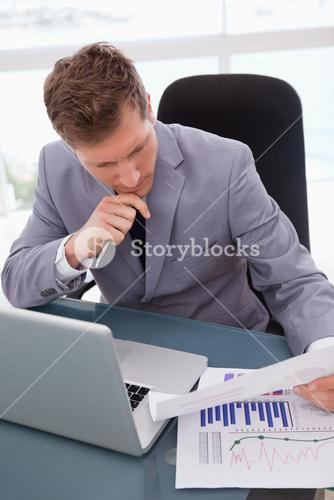 Businessman looking at market research results