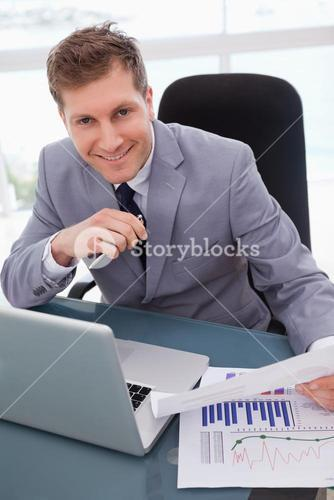 Businessman happy about market research results