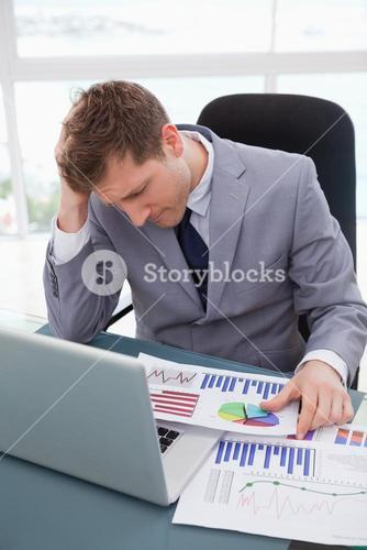 Businessman frustrated by market research results