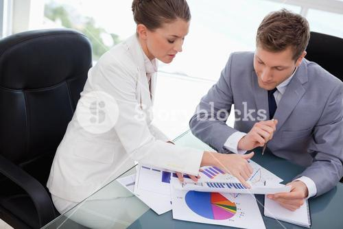 Business team analyzing market research results