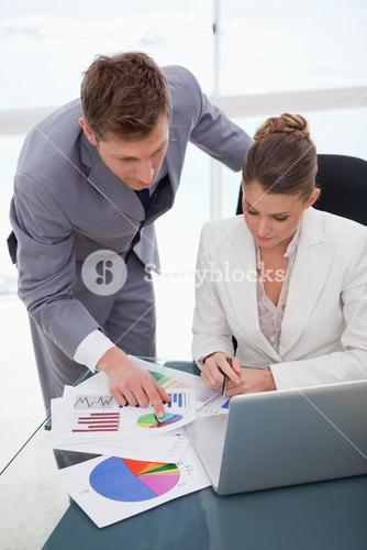 Business team analyzing survey results