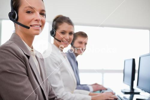Side view of customer service team