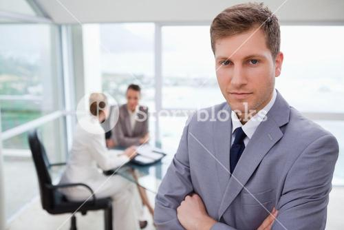 Young sales manager standing