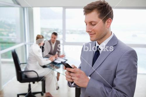 Sales manager writing text message
