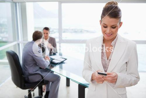 Marketing manager reading text message