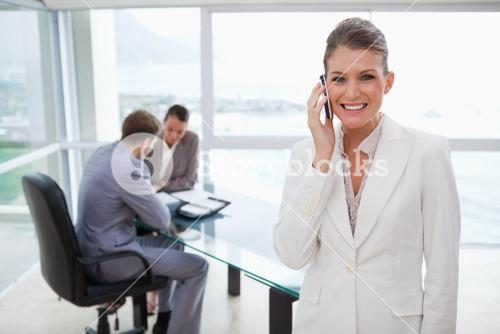 Smiling marketing manager on the phone