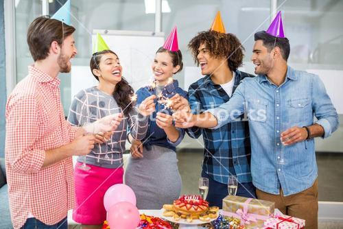 Happy executives celebrating their colleagues birthday