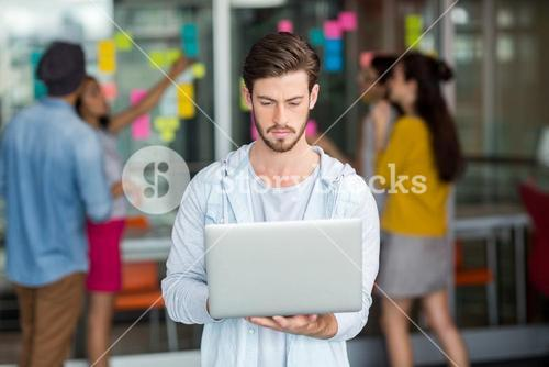 Attentive male executive using laptop