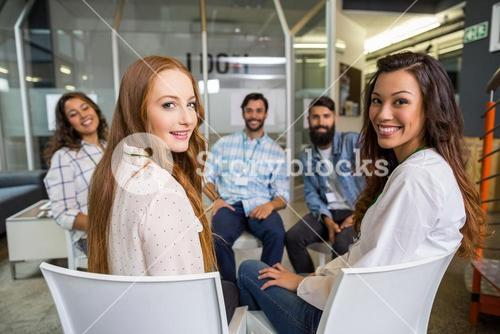 Portrait of smiling executive during meeting