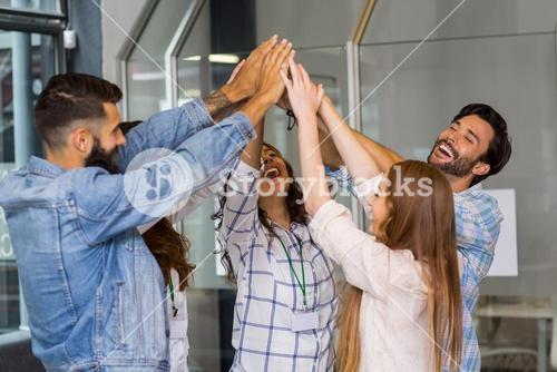 Group of business people forming a hand stack