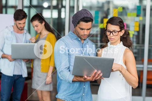 Attentive executives using laptop