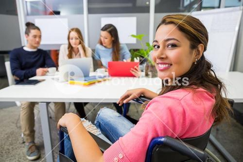 Portrait of smiling disabled executive in conference room