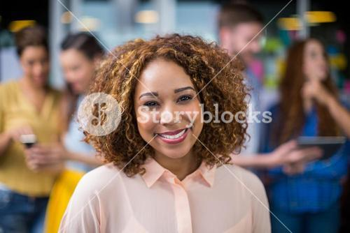 Smiling female executive in office