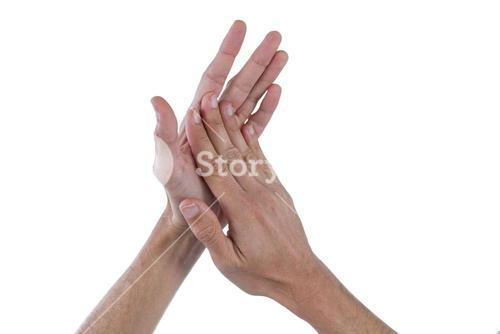 Hands with palms rubbing together against white background