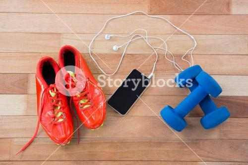 Mobile phone with headphones, shoes and dumbbells