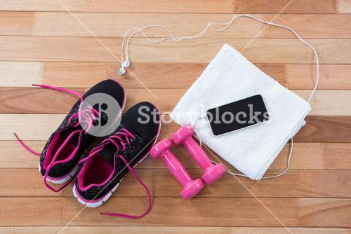 Mobile phone with headphones, shoes, towel and dumbbells