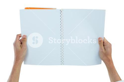 Hands holding a blank book