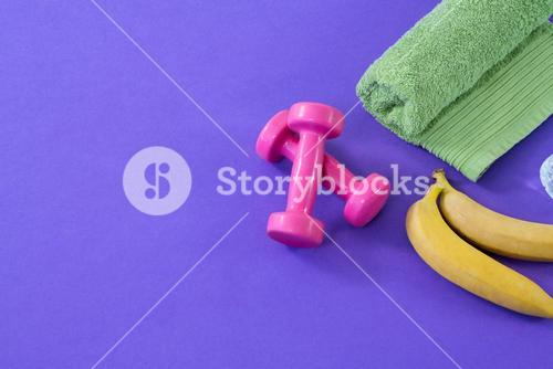 Dumbbells with banana and towel