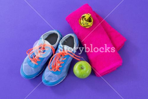 Sneakers, apple, towel and measuring tape