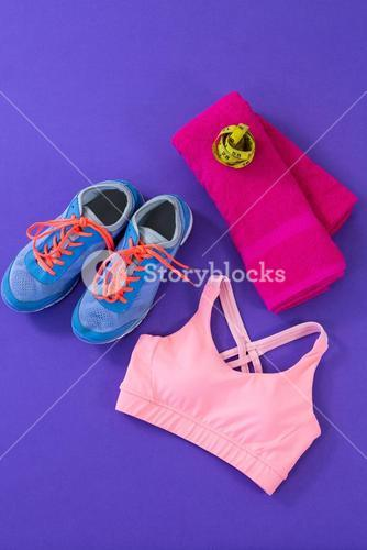 Sneakers, sports bra, towel and measuring tape