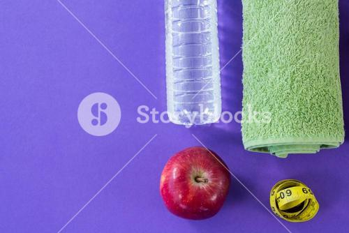 Water bottle, towel, apple and measuring tape