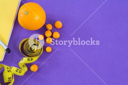 Citrus fruit with vegetable and measuring tape