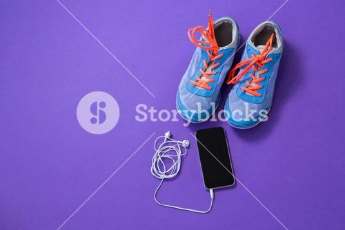 Sneakers, mobile phone with headphones