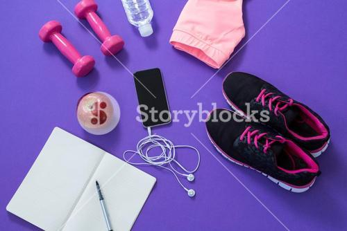 Fitness accessories with opened book, apple, mobile phone, headphones