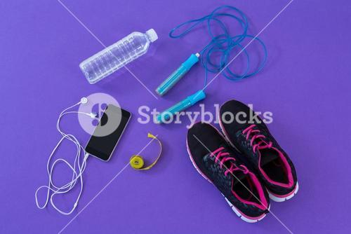 Fitness accessories, measuring tape and mobile phone with headphones