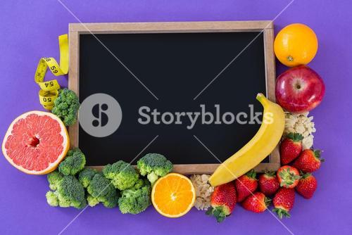 Slate arranged with various fruits and vegetable