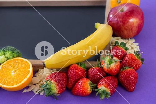 Slate arranged with various fruits