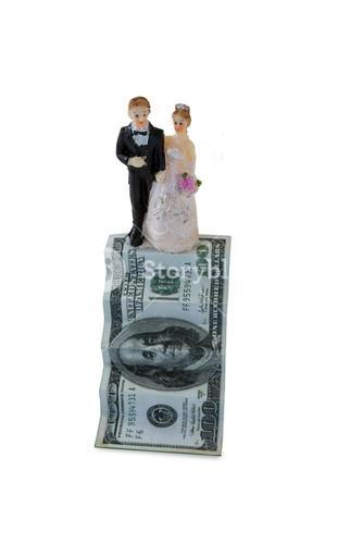 Wedding couple figurines on US dollar banknote