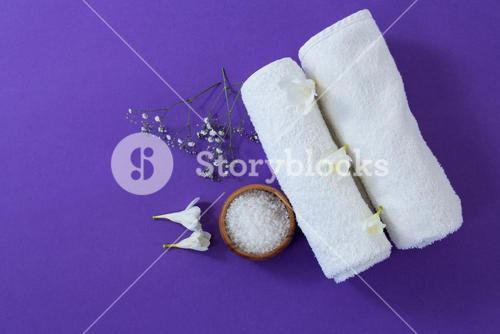 Spa accessories on purple background