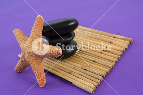 Zen stones with star fish on bamboo mat