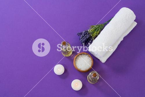 Spa accessories arranged on purple background