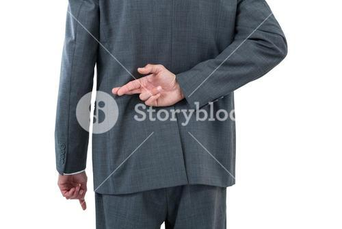 Businessman standing with figure crossed