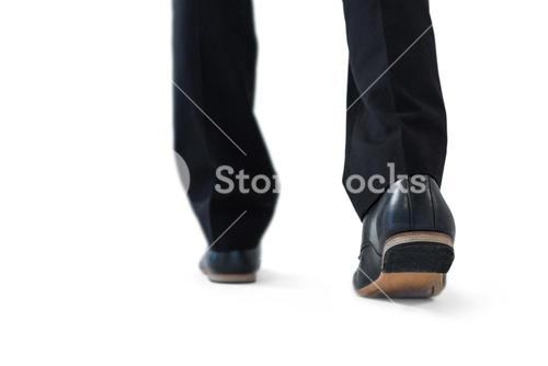 Businessman walking on while background