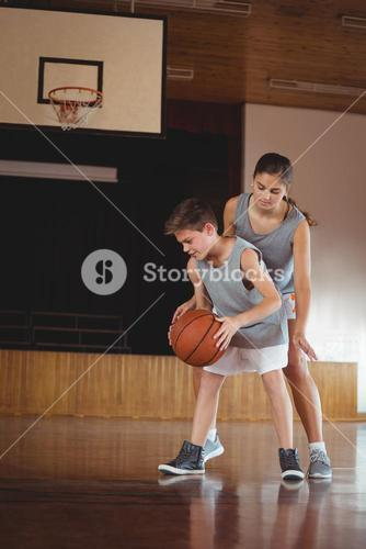 School kids playing basketball