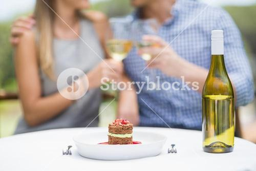 Close-up of food and bottle of wine arranged on table
