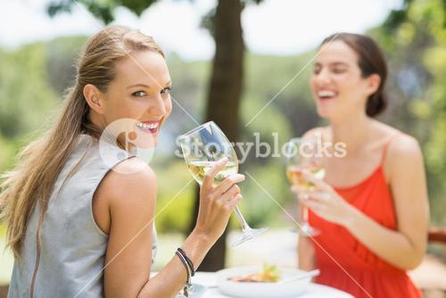 Friends laughing while drinking wine